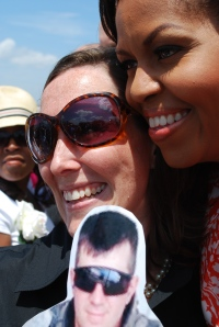 "Vivian Greentree holds her husband ""on a stick"" while posing with Mrs. Obama"